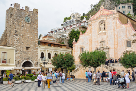 bystanders: Bystanders and the bridal party are waiting for the bride and the groom in front of the Church of St. Joseph on Piazza IX Aprile - Taormina, Sicily, Italy, 22 October 2011 Editorial