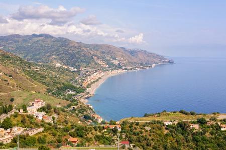 View of the coast of the Ionian Sea and the bay of Giardini Naxos from Teatro Greco - Taormina, Sicily, Italy Stock Photo - 80226253