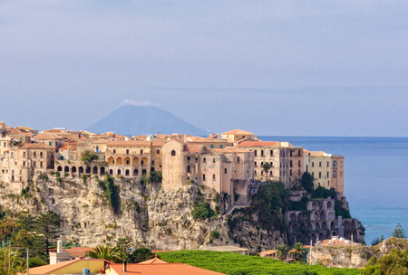 tyrrhenian: Tropea, a famous bathing place  situated on a reef in the gulf of St. Euphemia with the Aeolian Island Lipari in the background - Calabria, Italy