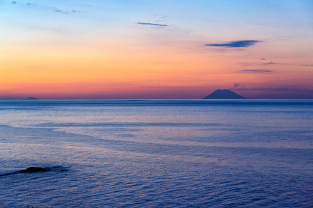 Twilight over the Tyrrhenian Sea and the Aeolian Island Lipari on the horizon - Tropea, Calabria, Italy