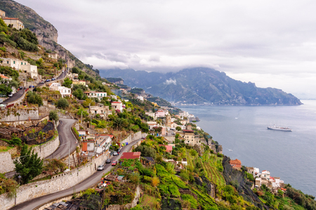 Hairpin bends of  narrow zigzagging streets that climb up the steep slopes - Amalfi, Campania, Italy
