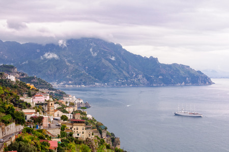 A cruise ship arrives in port before an autumn storm hits Amalfi - Campania, Italy