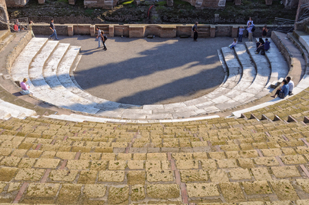 Tourists visit the Teatro Grande, the horseshoe-shaped  Roman theatre of ancient Pompeii - Campania, Italy, 31 October 2011 Stock Photo - 82218276