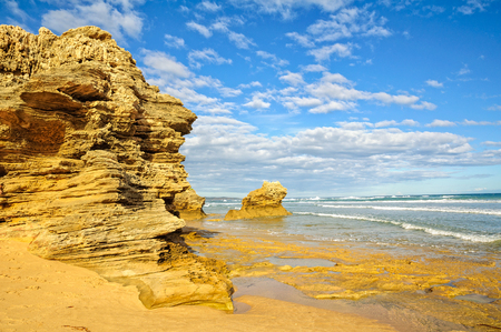 lonsdale: Sculptured rocks under blue sky and light clouds at   Point Lonsdale, Victoria, Australia Stock Photo