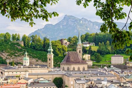 Franciscan Church (Franziskanerkirche) and Mount Untersberg photographed from the Capuchin Monastery (Kapuzinerkloster) - Salzburg, Austria Stock Photo