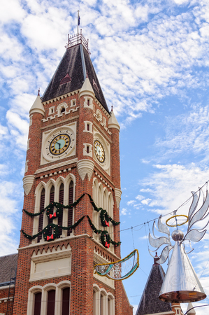 Clock tower of the Town Hall with Christmas decoration - Perth, WA, Australia