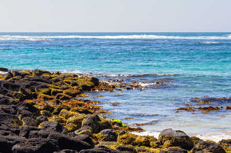 Choppy water washes the stones around Griffiths Island - Port Fairy, Victoria, Australia Reklamní fotografie