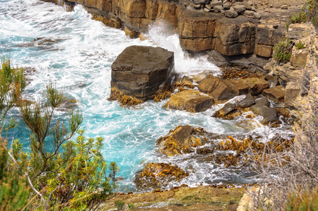Rocks being eroded by waves and wind at the Tasman Arch - Eaglehawk Neck, Tasmania, Australia