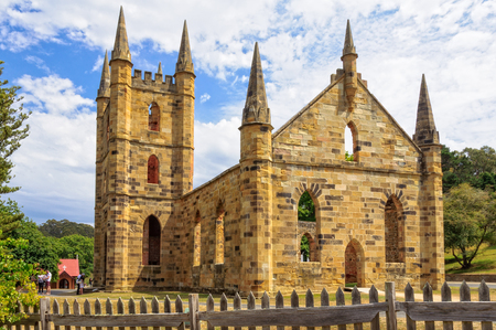 The ruin of the Convict Church, which was never officially consecrated, and St David's Anglican Church at the Port Arthur Historic Site - Tasmania, Australia