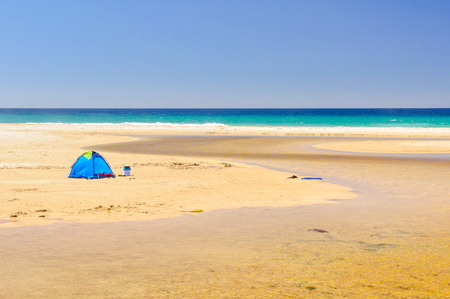 Beach tent at the mouth of the Little Beach Creek in Chain of Lagoons on the East Coast of Tasmania, Australia Stock Photo