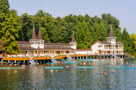 Bathers enjoy an unrivaled experience in the world's largest natural thermal lake - Heviz, Hungary, 4 September 2011