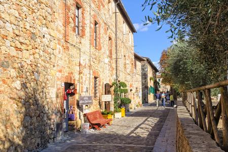 Tourists walk in Via I Maggio -Monteriggioni, Italy