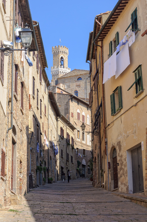 Walking up to the Town Hall (Palazzo dei Priori) - Volterra, Tuscany, Italy Stock Photo