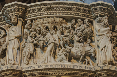 Presentation in the Temple and Flight in to Egypt by Giovanni Pisano on the pulpit of the Cathedral - Pisa, Tuscany, Italy