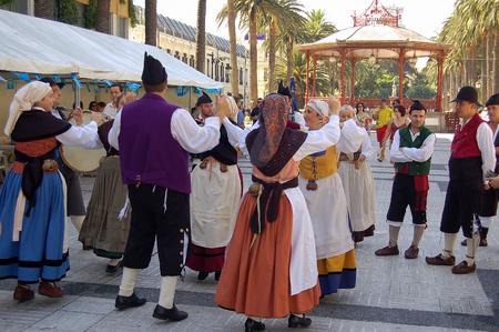 A folk group in traditional Galician costumes celebrates the new wine - La Coruna, Galicia, Spain, 9 September 2007 Editorial