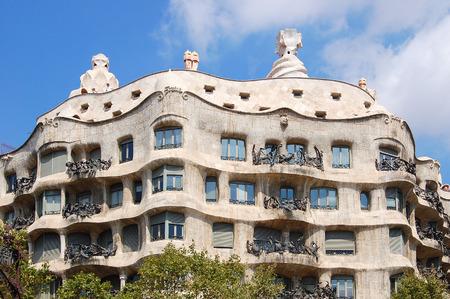 The undulating stone facade of Casa Mila,  the last building of Antoni Gaudí prior to Sagrada Familia - Barcelona, Catalonia, Spain, 1 September 2007