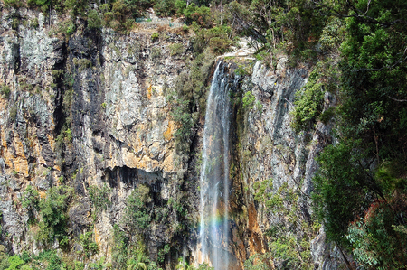 Rainbow and the majestic Purling Brook Falls in the Gondwana Rainforests - Springbrook, Queensland, Australia