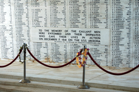 The solemn and sober USS Arizona Memorial honors the more than 1100 sailors and marines entombed in the sunken battleship - Pearl Harbor, Oahu, USA Editorial