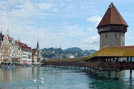 The famous Chapel Bridge (Kapellbrücke) is a covered wooden footbridge across the Reuss River - Lucerne, Switzerland