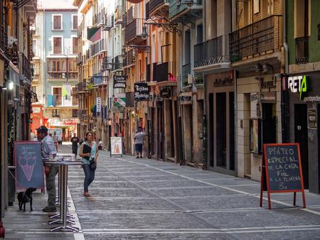 Just a few people are out on Estafeta Street (Calle de la Estafeta) during the siesta - Pamplona, Navarre, Spain, 4 September 2014