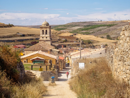 Belltower of the 16th century parish church of the Conception tucked down in a small valley of the Meseta - Hontanas, Castile and Leon, Spain Archivio Fotografico - 109482437