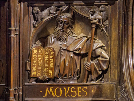 Choir seat carving of Moses in the Santa Maria de Leon Cathedral - Leon, Castile and Leon, Spain