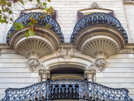 Beautifully shaped balconies on the modernist facade of a residential building - Barcelona, Catalonia, Spain Stock Photo