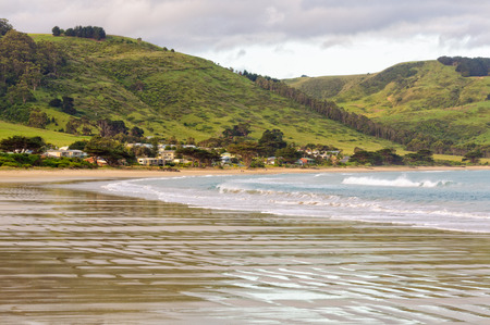 The main beach runs in an arc for 4 kms from the harbour in town to the mouth of Wild Dog Creek - Apollo Bay, Victoria, Australia 写真素材