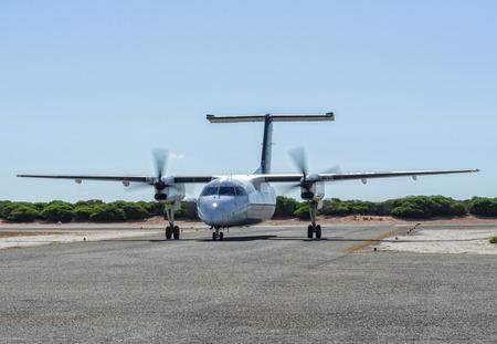 A twin-engine short-haul airplane on the taxiway - Monkey Mia, WA, Australia