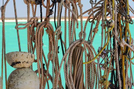Drying fishing ropes with knots and hooks - Monkey Mia, WA, Australia 写真素材