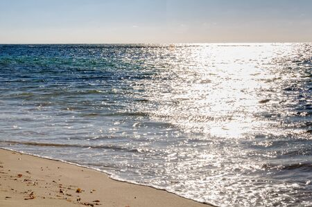 Gentle waves wash the beach - Cervantes, WA, Australia