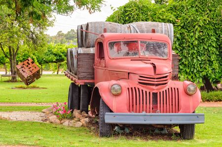 Old red wine barrel truck on display at Swanbrook Winery & Cafe in the Swan Valley - Perth, WA, Australia