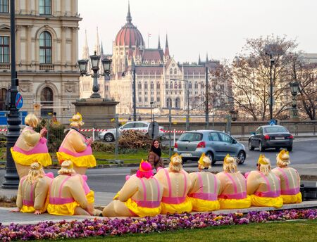 Members of a bachelor party have a short rest on Adam Clark Square - Budapest, Hungary