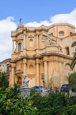 The Sicilian baroque Church of San Domenico and the statue of poet Mariannina Coffa - Noto, Sicily, Italy