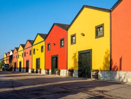 Colorful cellars (bodega) of the Vinas del Bierzo wine coop - Camponaraya, Castile and Leon, Spain