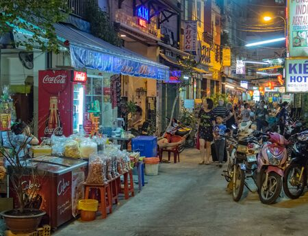 Bui Vien Street is a busy pedestrian area in the evening full of restaurants, bar, club and hotels - Ho Chi Minh City, Vietnam