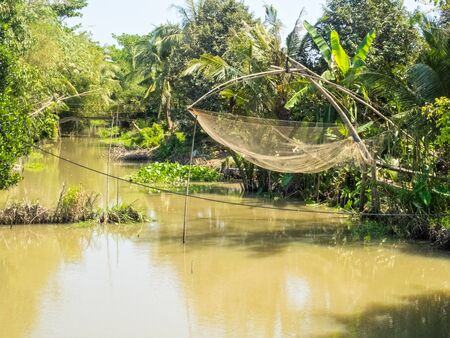 One of the millions of canals of the Mekong River Delta - Vinh Long, Vietnam