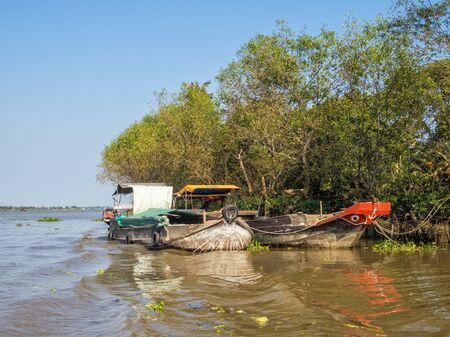 Traditional Mekong Delta freight boats - Vinh Long, Vietnam