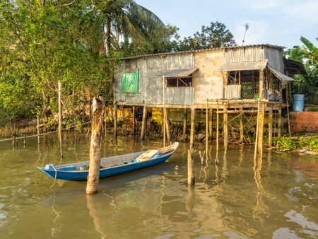 Stilt cabin and a boat in the Mekong River Delta - Can Tho, Vietnam Zdjęcie Seryjne