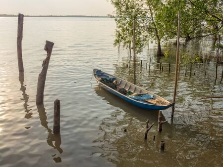 Traditional wooden boat in the Mekong River Delta - Can Tho, Vietnam