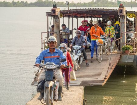 Passengers disembark from a small ferry in the Mekong River delta - Can Tho, Vietnam Publikacyjne