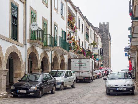 The cobbled main street, Rua de Compostela, on a foggy autumn day - Portomarin, Galicia, Spain