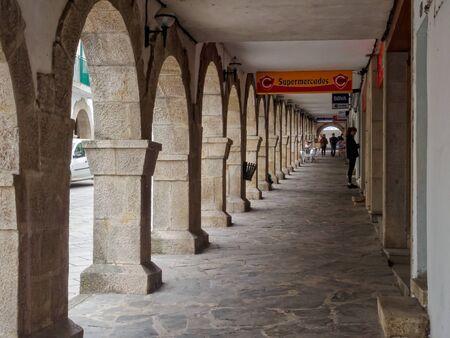 Stone colonnade on the main street, Rua de Compostela - Portomarin, Galicia, Spain