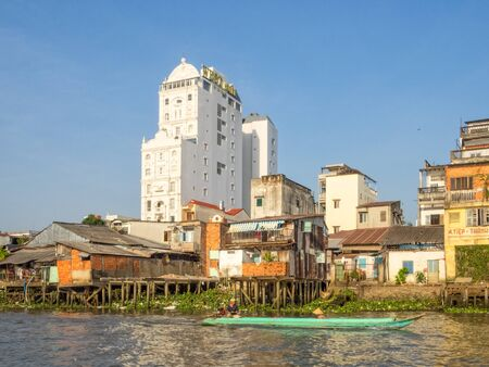 Houses along the Mekong River a world apart - Can Tho, Vietnam