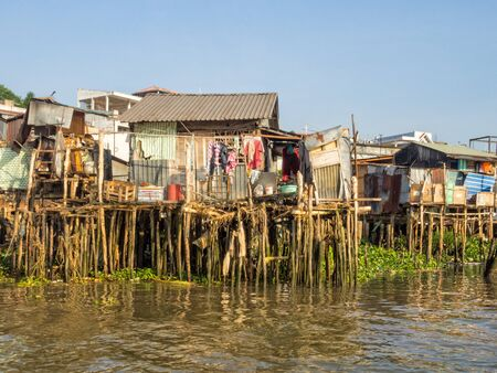 Traditional stilt houses along the Hau River in the Mekong Delta - Can Tho, Vietnam Zdjęcie Seryjne