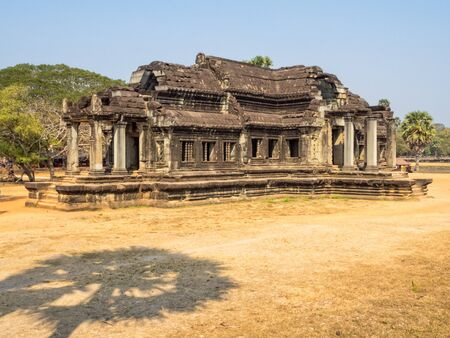 The shadow of a palm tree and the South Library of Angkor Wat - SIem Reap, Cambodia