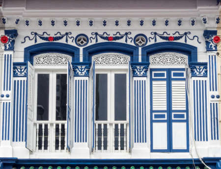 Traditional white and blue facade of a shophouse in Little India - Singapore