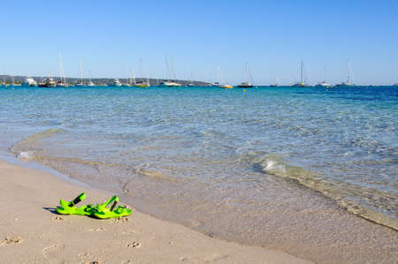 Gone swimming. A pair of green sandals left behind on Bay Beach - Dunsborough, WA, Austtralia