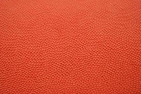 textured: Orange texture looking like basketball leather material