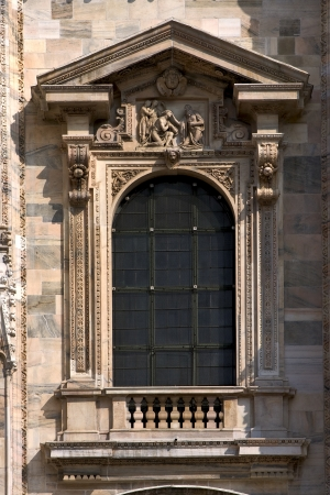 curch: a window in the front of the dome of milan